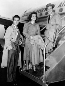 Betsy Blair, Montgomery Clift, Gene Kelly - **  FILE ** In this Nov. 1948, file photo, actress Betsy Blair is flanked by actors Montgomery Clift, left, and Gene Kelly as they board an airplane for London at La Guardia Airport in New York City.  Betsy Blair, the Oscar-nominated actress and teenage bride of Gene Kelly, has died in London at the age of 85, her publisher said on Thursday, March 19, 2009. The New Jersey-born actress, who later married film Karel Reisz, suffered from cancer and died on March 13. Mark Searle, the publisher of Blair's 2003 autobiography, confirmed her death. (AP Photo/file )