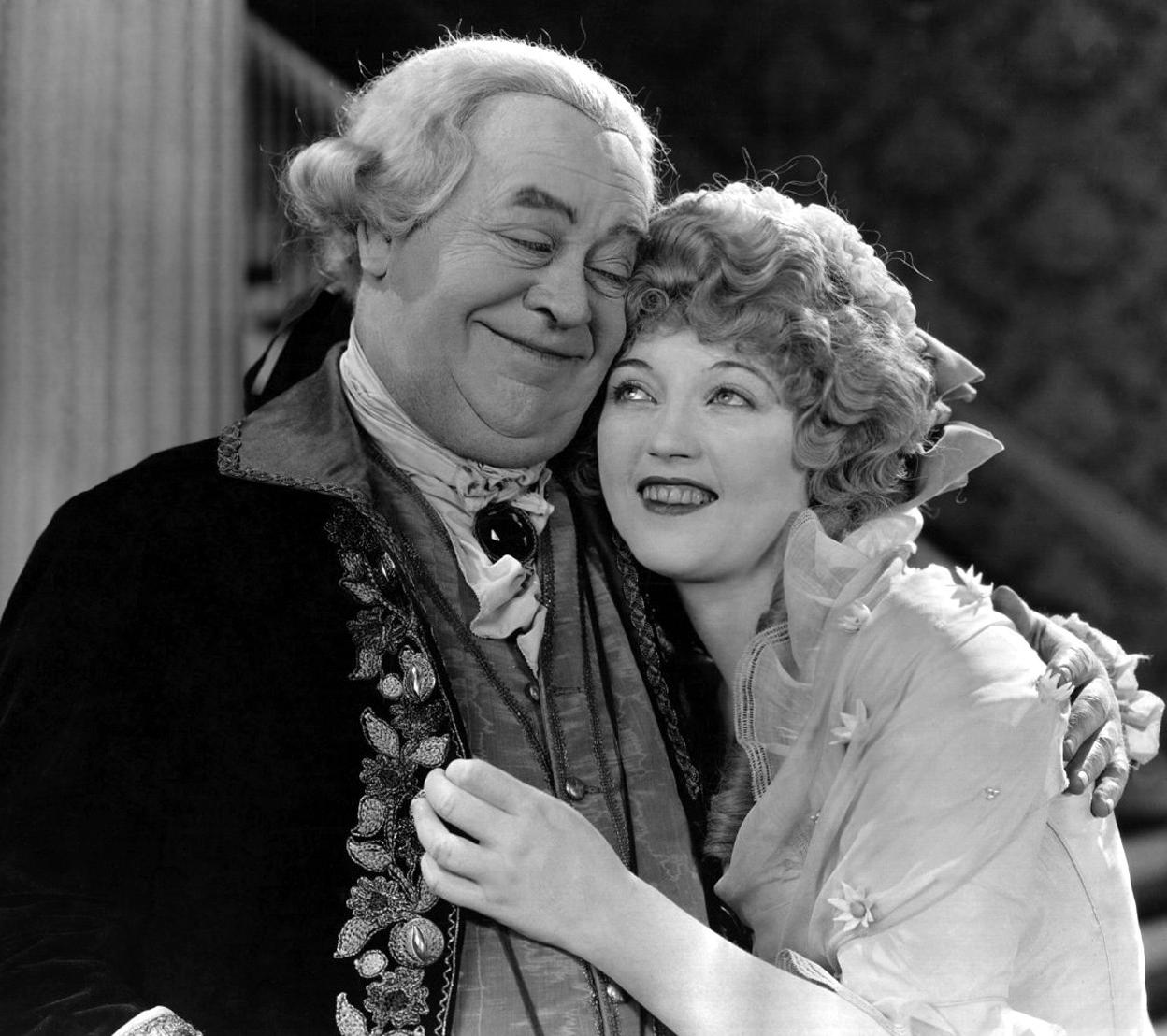 Maclyn 4 - 1924: American actress Marion Davies (1897 - 1961) shares an affectionate moment in a scene from 'Janice Meredith', adapted from the novel by Paul Leicester Ford and directed by E Mason Hopper for Cosmopolitan/MGM.