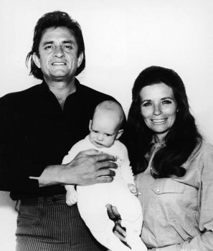 June Cash Dies At Age 73 - UNDATED:  (FILE PHOTO)  Country musicians Johnny Cash and his wife June Carter Cash hold their infant son John Carter Cash in a promotional portrait for the film