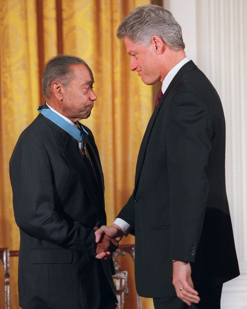 CLINTON BAKER - President Clinton shakes hands with Vernon Baker after presenting him with a Medal of Honor, Monday Jan. 13, 1997 at the White House. In a long-awaited ceremony, Baker and six other  World War II veterans became the first black soldiers of that conflict to receive the medal. Baker is the sole survivor of the group. (AP Photo/Ruth Fremson)