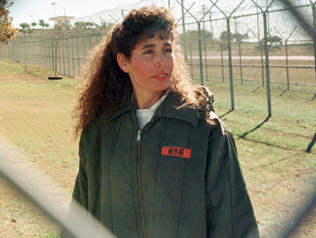 PHO-10Sep23-254489 - 12/18/97 -  A Texas judge on Thursday set a Feb. 3 execution date for convicted murderer Karla Faye Tucker, moving her closer to becoming the first woman executed in the state since the Civil War.Unless a state parole board recommends the sentence be commuted to life in prison, Tucker would also become only the second woman executed in the United States since the U.S. Supreme Court reinstated capital punishment in 1976. Tucker peers out behind fence in  the recreation yard at the Mountan View Unit in picture made on December 15.  rk/Photo by Ron Kuntz REUTERS