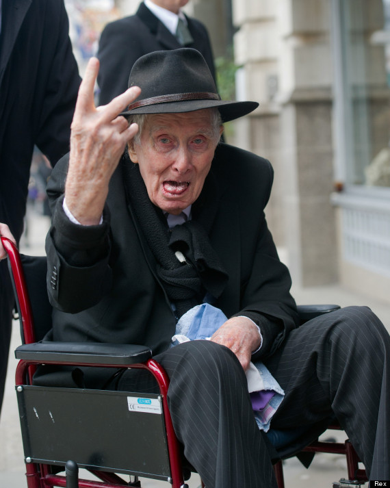 Funeral of Bruce Reynolds, St Bartholomew the Great, Smithfield, London, Britain - 20 Mar 2013 - Mandatory Credit: Photo by Rex Features (2213664a) Ronnie Biggs gives the 'V sign to press as he arrives Funeral of Bruce Reynolds, St Bartholomew the Great, Smithfield, London, Britain - 20 Mar 2013 Great trainer robber Ronnie Biggs gives the