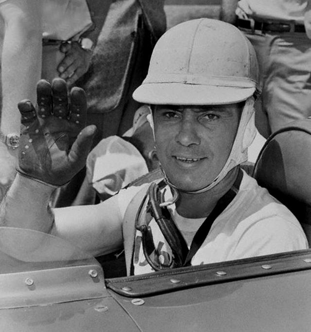 Race Car Driver Bill Vuokovich Waving from Car -