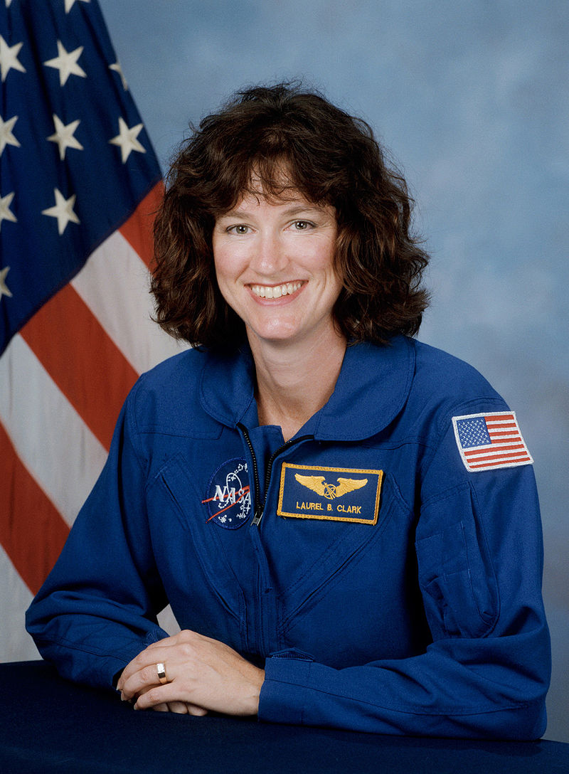 800px-Laurel_Clark,_NASA_photo_portrait_in_blue_suit -